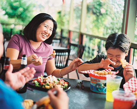 Family eating with Busch Gardens Tampa Bay Annual Pass discount